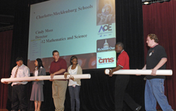 CMS students assemble a pipeline to show the flow of math, science and engineering education in the district.