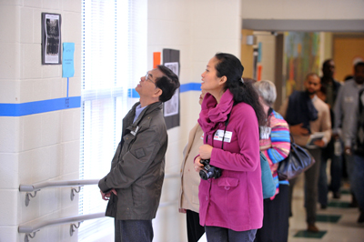 Visitors viewing the historic time line